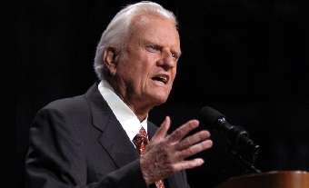 The Rev. Billy Graham preaches to the audience at the Ford Center Sunday, June 15, 2003, in Oklahoma City. (AP Photo/Jeffrey Haderthauer)