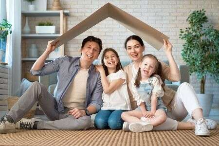 141356596-mother-father-and-children-girls-in-the-room-with-a-symbol-of-roof-concept-of-housing-for-young-fami